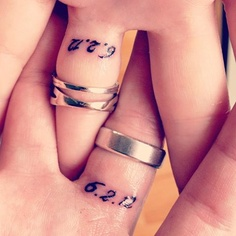 Three Reasons To Choose Wedding Ring Tattoos Designs 0013